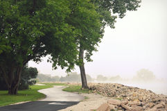 Shoreline Path Lake Michigan. The beautiful shoreline path along Lake Michigan near the Kemper Center in Kenosha, Wisconsin on a foggy misty morning Stock Photo