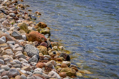 Shoreline of Pewaukee Lake in Wisconsin. Shoreline of lake in Pewaukee, Wisconsin in summer royalty free stock images