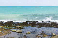 Shoreline with rocks and small waves Royalty Free Stock Photos