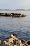 Shoreline Sea Jetties And Islands Scenery. View from a shoreline of sea, jetties and islands Royalty Free Stock Photo