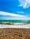 Shoreline. The shoreline of a shingle beach Stock Images