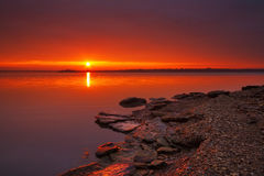 Shoreline Sunrise. View of the rocky shoreline of Truman Lake taken outside of Clinton, Missouri at the Cooper Conservation area Stock Photography