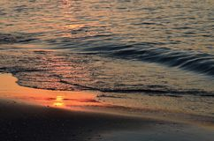 Shoreline at sunset Stock Photo