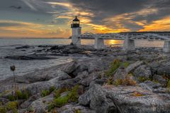 Shoreline Sunset at Marshall Point Lighthouse stock photos