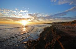 Shoreline at sunset, Puerto Cabopino, Spain. Royalty Free Stock Images