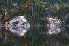 Shoreline of Unpopulated Area of Trees and Rock Royalty Free Stock Photos