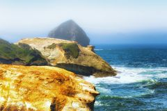 Shoreline view from Cape Kiwanda. Sandstone cliffs and haystack rock dominate this Pacific shoreline view at Cape Kiwanda in Pacific City on the Oregon Coast Royalty Free Stock Photos