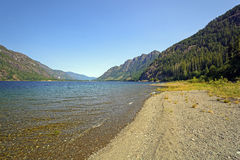 Shoreline View of a Long Mountain Lake Stock Image