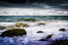 Shoreline With Wild Sea And Storm Wind. A shoreline view with wild running sea, storm and fierce wind Royalty Free Stock Images