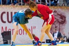 Shorena Sharadze (R) and Katsiaryna Prakapenka (B) fights Stock Images