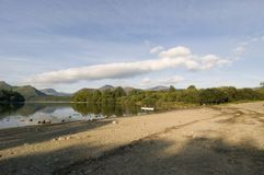 The shores of Derwent Water and Keswick on a summers morning, Lake District, Cumbria England stock photography