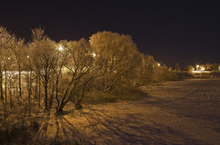 Shores of an icy river at night. Royalty Free Stock Image