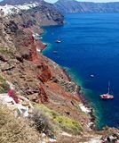 The shores of the island of Santorini. The island of Santorini overlooking the waters of the Mediterranean Sea. Its shores are steep and non-criminal. At the Royalty Free Stock Photos