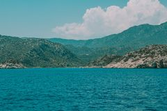 Shores and sea of turkey. Blue clear water, blue sky with white clouds royalty free stock photography