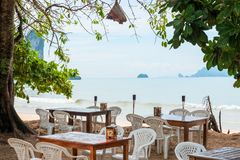 on the shores of the sea tables and chairs in the restaurant stock photo