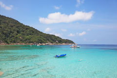 The shores of Similan Islands. The picturesque shores of magical Similan Islands. Shallow beach with warm turquoise waters fenced enclosure rope with floats Stock Photos