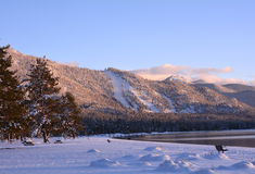 Shores of South Lake Tahoe at Sunset. A quiet and lonely view of the shores of South Lake Tahoe at Sunset. Recent snowfall blankets the beach as the light begins Stock Photography