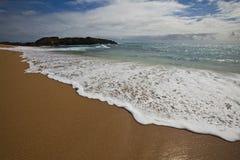 Shorewash savonneux photographie stock libre de droits