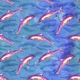 Short-beaked common dolphin in purple color palette, hand painted watercolor illustration, seamless pattern on blue ocean surface. With waves background Stock Photos