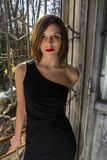 Short Black Dress. Beautiful young model posing in a short black dress, in abandoned place stock photography