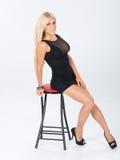Short black dress themed shoot. Stock Images