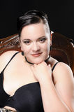 Short black hair. Portrait of a adult plus size model with short black hair smiling into the camera Stock Image