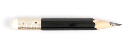 Short Black Pencil. In White background Stock Image