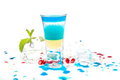 Short blue coctail with ice and color drops Stock Photo