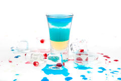 Short blue coctail with ice and color drops Stock Images