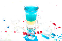 Short blue coctail with ice and color drops Stock Image