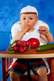 Short boy with vegetables Stock Photos