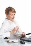 Short break. Businesswoman relaxing in her office stock image
