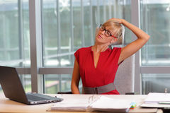 Short break for exercise on chair  in office. Caucasian business woman in eyeglasses relaxing neck,stretching arms - short break for exercise on chair  in office Stock Photo