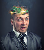 Short circuit in businessman head Royalty Free Stock Image
