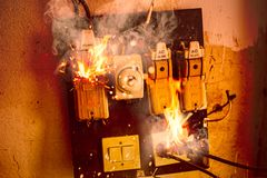 Free Short Circuit Fire Burn Danger Of Old Electrical Wire Plug And Broken Circuit Breaker Stock Photos - 158394423