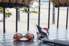 Short city break tourist essentials, sunglasses, smartphone and Royalty Free Stock Photography