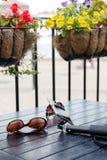 Short city break tourist essentials, sunglasses, smartphone and Stock Photo