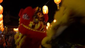Short Clip of Chinese New Year Dragon Dancers Passing by, with Audio. In Chinatown of Georgetown, Malaysia stock video footage