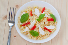 Short Cut Pasta. With Basil, Red Peppers and Fresh Goat Cheese stock photos