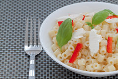 Short Cut Pasta. With Basil, Red Peppers and Fresh Goat Cheese Royalty Free Stock Image