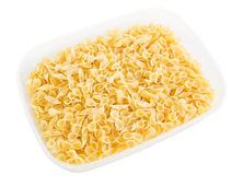 Short-cut pasta in plastic container. Royalty Free Stock Images