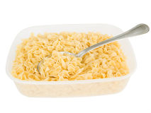 Short-cut pasta with spoon in plastic container. Stock Photography
