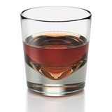 Short drink shot glass with whisky type drink Royalty Free Stock Photo