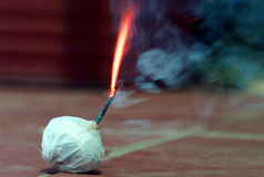 Short fuse. Fuse burning with sparks flying and smoke Royalty Free Stock Photos