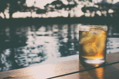 A short glass of ice beer at pool Stock Images