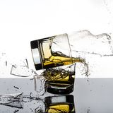 Spectacular High Speed shot of whiskey Glasees breaking stock image