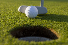 Short Golf Putt. A very short putt in the game of golf on a putting green at a golf course with copy space Royalty Free Stock Photo