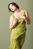 Short hair brunette woman with green dress Royalty Free Stock Photos
