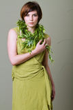 Short hair brunette woman with green dress Stock Photo