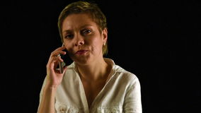 Short hair business woman talks by mobile phone stock video footage